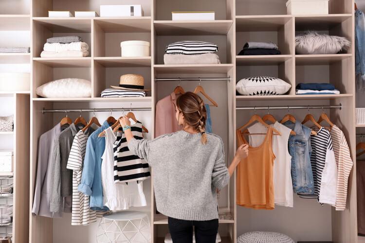 woman organising wardrobe