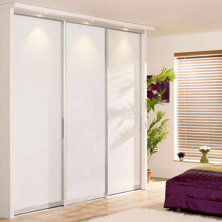 White Sliding Wardrobe Doors - Monaco Silver Frame w/ Pure White Glass Panels.